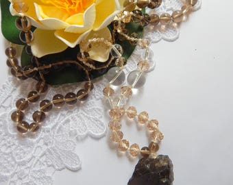 A long necklace with a tassel     Necklace of smoky quartz and crystal.