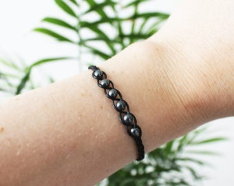 "Bracelet ""&"" braided anthracite grey pearls, black cord and button wood"
