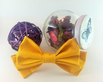 Bow tie yellow brooch