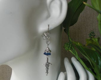 sword of truth in a sapphire blue glass Bell