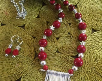 Necklace with Red beads and white silvercolored pendant with matching earrings! Text : 770 731-3422 for more pic from my Collection.