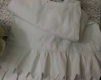White shabby old cotton underskirt with embroidered initials