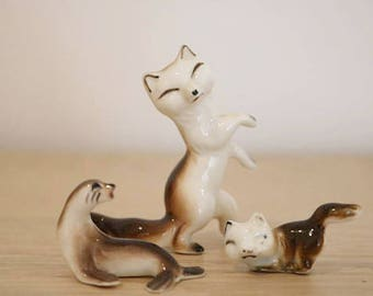 Three 1970s miniature Critters, two Cats and one Seal or Sea Lion. No damage or repairs