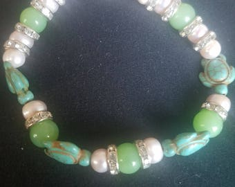 Pink pearls, turuoise turtles, and round jade bracelet