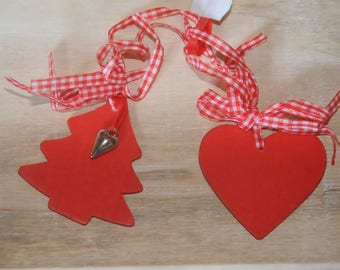 set of two heart ornaments and pine wood