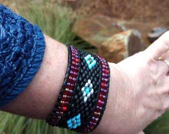 Black, Turquoise and Rudy Red Seed bead Cuff Bracelet with Sterling Silver Aztec Sun God Vintage Button, Boho Black Leather Wrap Bracelet