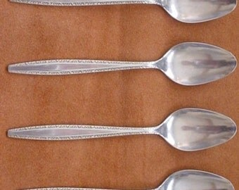 International Stainless Fascination Four Oval Soup Spoons