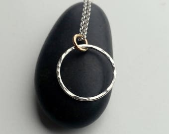 Silver hoop pendant with gold hoop