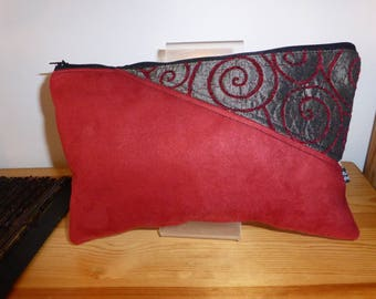 Suede with application of fancy fabric pouch.