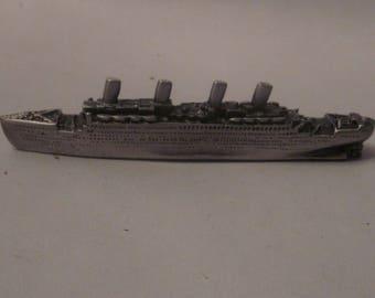 Titanic metal figurine