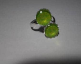 Ring has two lime green cabochons