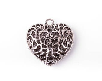 Decorated with scroll work heart pendant