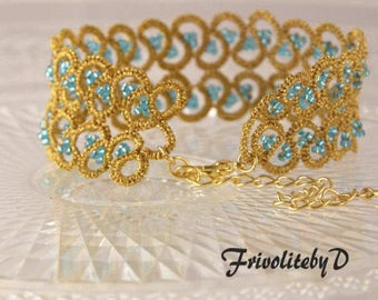 Handmade tatted cuff bracelet in gold withth blue glass beads
