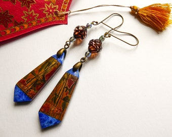 Graphic earrings in the careers of Cairo