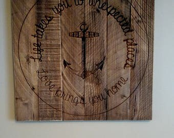 Life takes you to unexpected places, Love brings you home sign on distressed hardwood