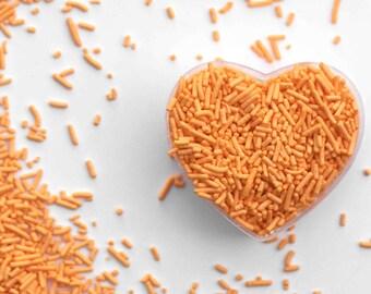 Pastel Orange Crunchy Jimmies™, crunchy sprinkles, skinny sprinkles, sugar strands, fancy sprinkles, orange sprinkles, orange jimmies
