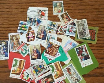 20 Christmas themed used vintage US postage stamps for crafting scrapbooking or collecting