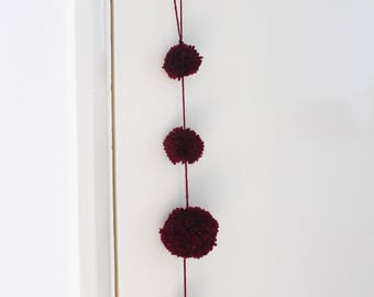 Pom Pom and tassel yarn door knob hanging custom made decoration by Ella Scribbles