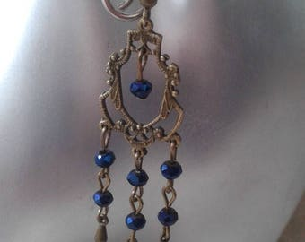 Blue beads and bronze earrings