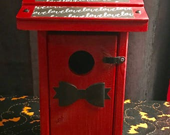 Red bats and hearts bird house