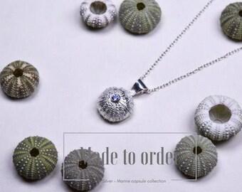 Silver and tanzanite sea urchin pendant