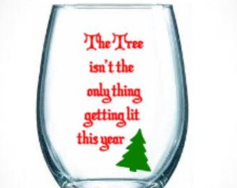 getting lit/christmas/white elephant/gift/tree/drinking/coffee mug/wine/glass