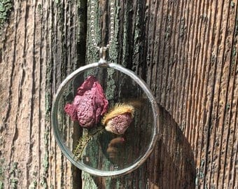 Two poppies encased in a glass jewel.
