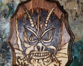 She Creature , wood burned plaque