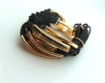 Leather bracelet plaited gold cuff