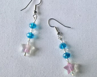 Blue sparkle bead and star dangly earrings.