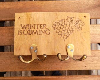 """Game of Thrones hand-burnt """"Winter is Coming"""" coat rack with direwolf sigil"""