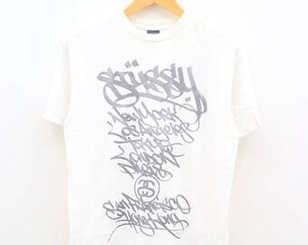 Vintage STUSSY New York Los Angeles Tokyo London Paris San Francisco Hong Kong Streetwear Hip Hop White Tee T Shirt Size M