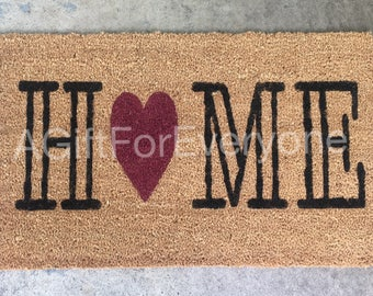 Home with colored heart doormat