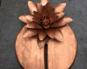 Copper water lily on a leaf