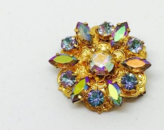 Brooch vintage Crystal Aurora Borealis & clear blue / old trombone closure has the fraincaise.