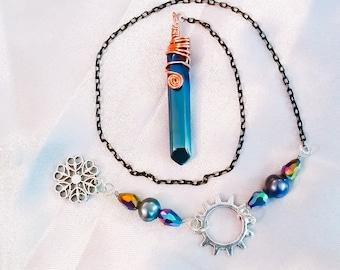 Titanium quartz crystal point pendulum