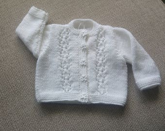 Hand knitted newborn baby cardigan in white with lacy front panel