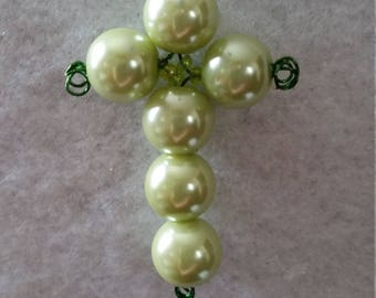 Small green pearl beaded cross pendant