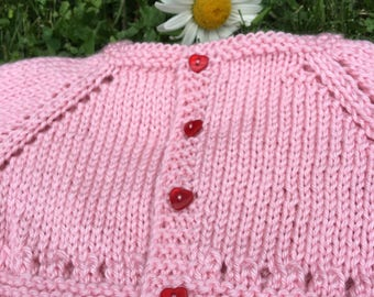 Baby shrug in pink with heart buttons, ages newborn to 12 months