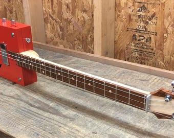 Three string cigar box guitar