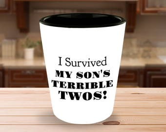 I Survived My Son's Terrible Twos! - 1.5 oz Ceramic Shot Glass- White on the Outside - Black on the Inside - Unique gift idea!