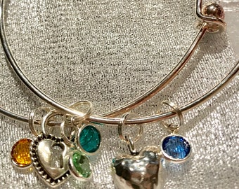 2 bangle bracelets set with Swarovski crystals and heart charms.
