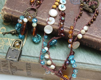 Teal and Amber Bohemian Crocheted Bead Necklace with Tiny Vintage Lock Pendant