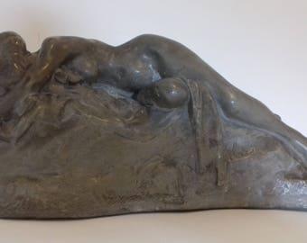Elongated nude woman sculpture