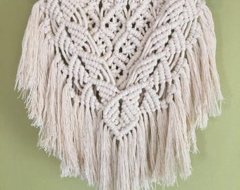 Decorative wall hanging in neutral color