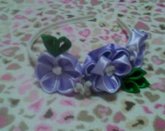 Handmade purple flower headband with floral design.