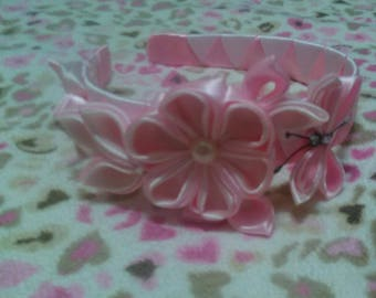 Handmade pink flower headband with floral design.