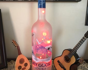 Grey Goose liquor bottle with LED RED battery light. You can pick your color lights