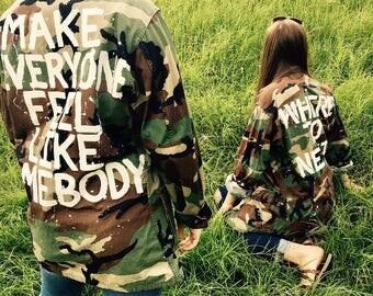 "Camo painted jacket ""Make everyone feel like somebody"""