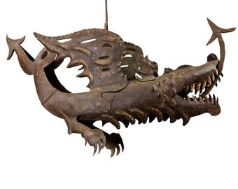 large dragon shop sign of handforged iron ca. 1890